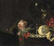 A 'Roemer' with white wine, a partially peeled lemon, cherries and other fruit on a silver plate with a rose and grapes on a stone ledge